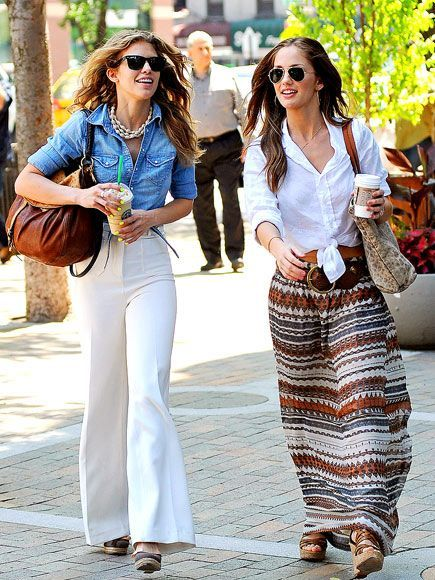 AnnaLynne McCord in a white flared pants paired with a denim fitted shirt and a statement chunky necklace and Minka Kelly is in a patterned maxi skirt, chunky wedges and crisp white shirt tied in a knot. #fashion #summer