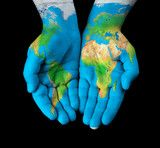 Map painted on hands showing concept - the world in our hands