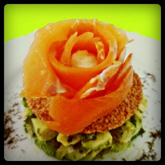 Smoked Salmon Rose in the Heart of Lime Sorbet on a Bed of Avocado and Cucumber    INGREDIENTS  Serves 4    - 4 scoops of lime sherbet  - 2 buckwheat pancakes or fajitas  - A few sprigs of dill  - 1 tablespoon coriander  - 1 lime  - 1/2 shallot  - 1 cucumber  - 200g of smoked salmon  - Olive oil  - Sea salt  - Freshly ground pepper 5 bay