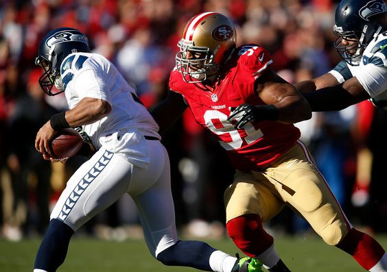 Description of . San Francisco 49ers' Ray McDonald (91) sacks Seattle Seahawks starting quarterback Russell Wilson (3) in the first quarter ...