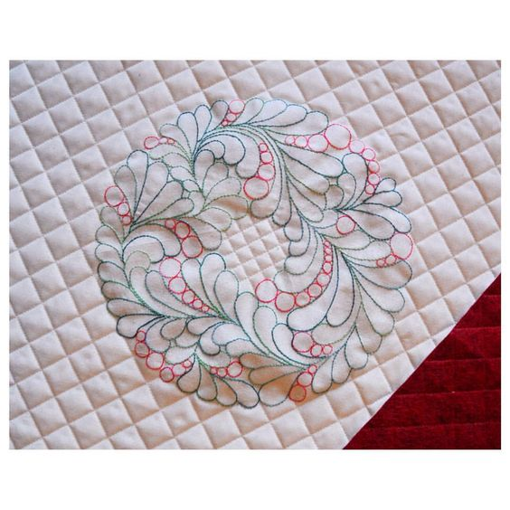 My embroidered version of the circle wreath pattern, pinned below.