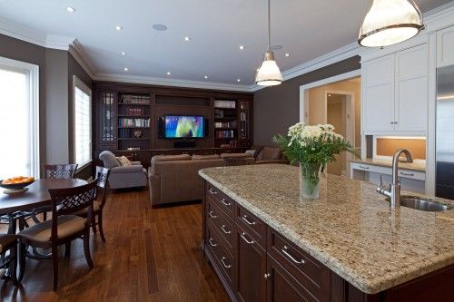 I love the contrasting counters and island.  I also love the sitting area so close to the kitchen.