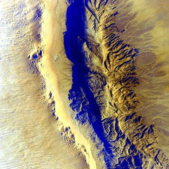 #Desert #EarthArt Not a color you might expect to see here. #YearInSpace  #green #earth #space #spacestation #iss