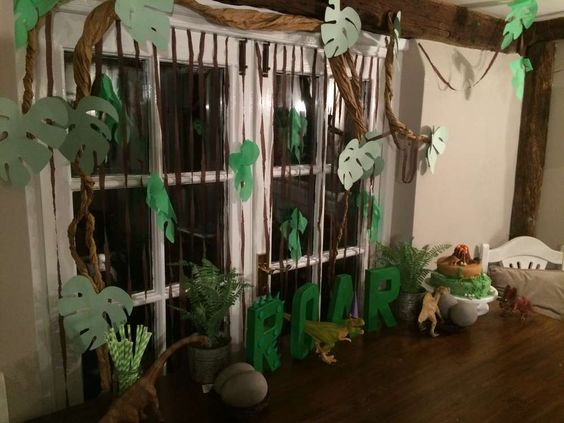 Jungle backdrop at a dinosaur birthday party! See more party planning ideas at CatchMyParty.com!