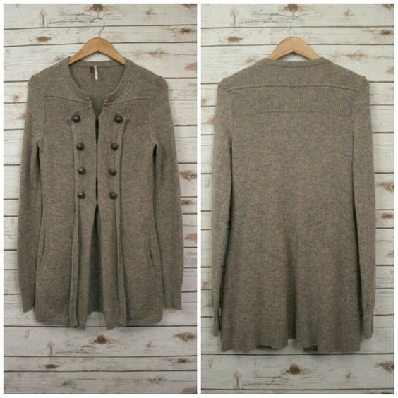Free People Military Wool Cardigan Sweater M Free People military sweater. Size M. Color is a mix of gray and taupe. Very cute!  Sweater remains in good condition but does have some flaws: there's a hole near the hem (can easily fix it) and the Free People tag became undone / unsewn on one side so it's hanging (as shown in the last picture).  Please look at the close up photos for a more accurate representation of it's color.  - Faux decorative buttons on the front - Partial hook and eye…