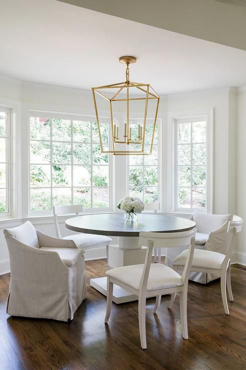 Natural Light Coming Through Bay Windows And A Darlana Large Lantern Light A Black And White White Round Dining Table Round Dining Room Sets Round Dining Room