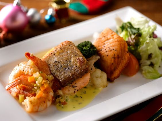 Fillet of Norwegian Salmon, Prawn Escabeche, and Salad green in Coriander butter
