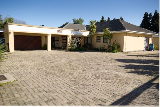 A rare find in today's market! R 2 650 000  Located in the old established and tranquil part of Durbanville, this substantial property is close to the central village with shops, medical facilities, schools and transport on your doorstep. The home is set on very large grounds and offers masses of accommodation with 6 bedrooms and en-suite bathrooms, spacious living areas and braai room, open-plan kitchen, study and so much potential waiting for your flair!