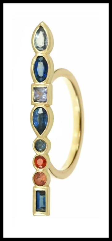 Long Stepping Stone ring by Ilana Ariel, with colorful gemstones set in yellow gold