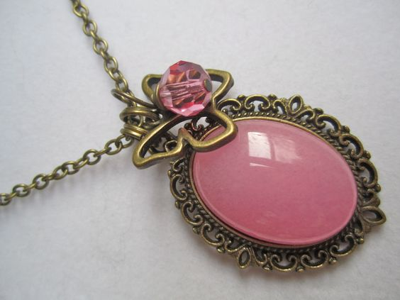 Pink Jade Butterfly long antique brass necklace with pink swarovski crystal. $25.00, via Etsy.