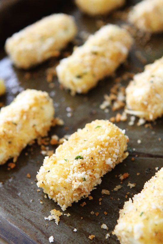 Baked Mozzarella Sticks...These easy baked mozzarella sticks can be made in advance and kept in the freezer! Perfect party food!