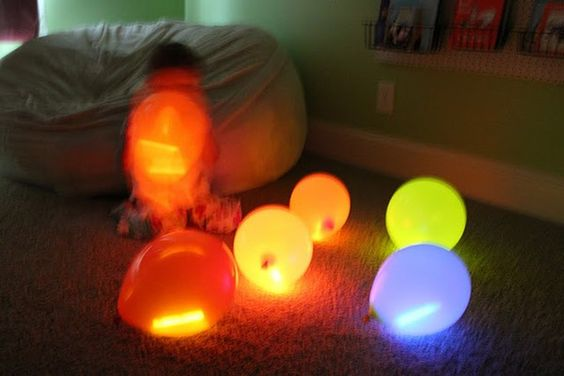 Think rainbow balloons on strings as outside decorations for a party!- put one glow stick inside each balloon,