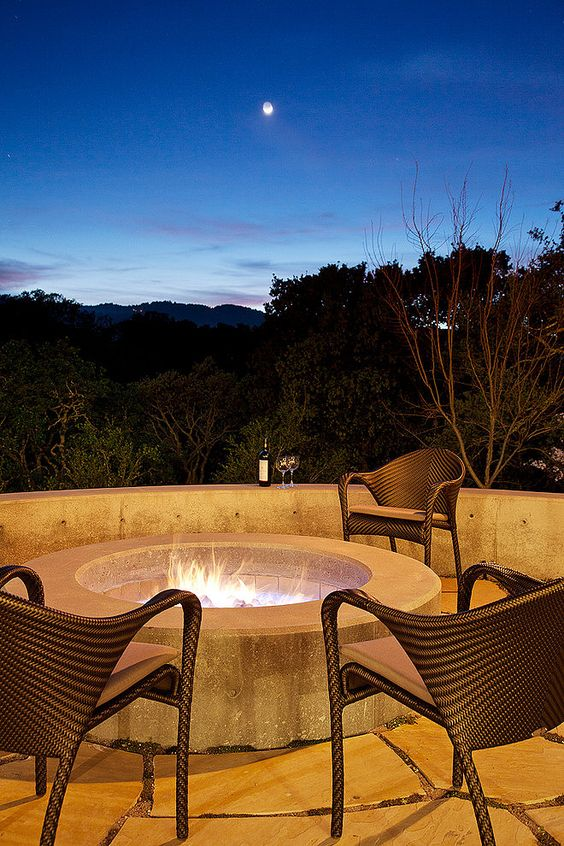 Wonderful Night View near Hillside Sanctuary Staprans Design House Terrace with Round Fire Pit and Rattan Chairs