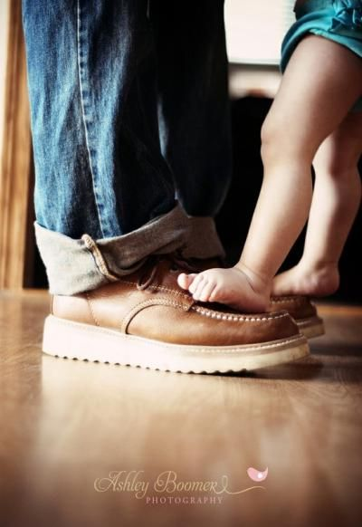 daddy and baby feet