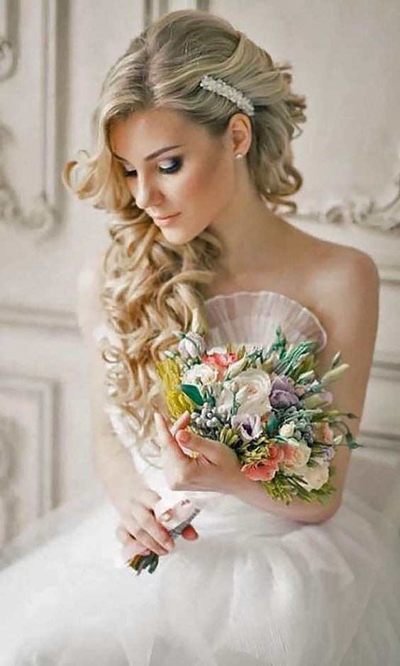 Wedding Hairstyles And#8211; Romantic Bridal Updos ❤ See more: http://www.weddingforward.com/romantic-bridal-updos-wedding-hairstyles/ #weddings: