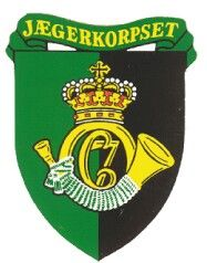 "Jægerkorpset wears the maroon beret , hunter's bugle on a black felt liner . After one year of satisfactory service and training in JGK ,the wearer is issued the shoulder patch ""JÆGER"" (English:Hunter) ,and may call himself by this name.Jægerkorpset is composed of around 150 highly trained soldiers ,with special expertise in counter-terrorism, demolitions, parachuting, and combat swimming, HAHO and HALO parachuting, infiltration, sabotage, reconnaissance and more."