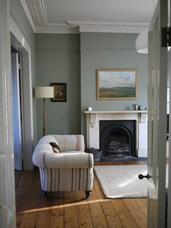 Modern Country Style: Modern Country Living Room Quest... Click through for details. Sofa upholstered using vintage grain sacks plus AWESOME cast iron arch and marble fireplace!: