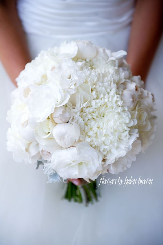A beautiful and luscious crisp white wedding bouquet with David Austin Roses, Garden Roses, Lisianthus and Chrysanthemums | Floral design by Flowers By Helen Brown.