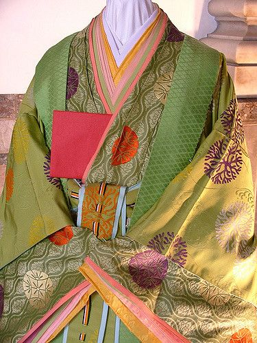 Photos at the Kyoto museum of a mannequin wearing heian era costume. 2008 is the 1000 year anniversary of the 'Tale of Genji'.