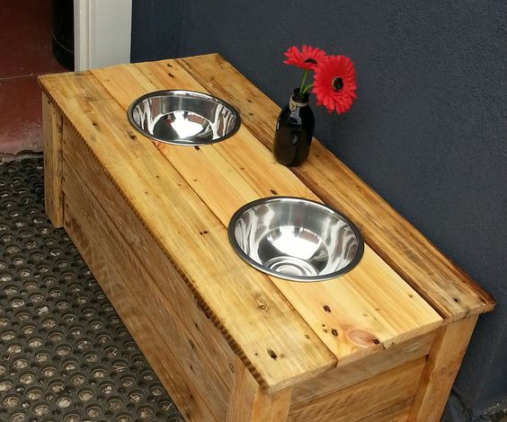 Made from 100% recycled pallets, this dining table is perfect for our large fur baby. He cant push over his water or food bowl as he eats as most dogs ...