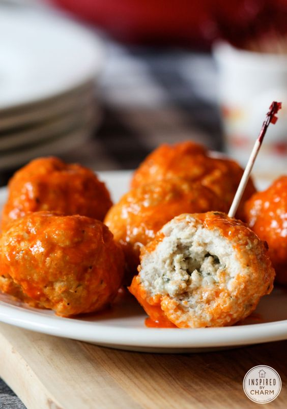 Tasty, easy & impressive for parties! Blue Cheese Stuffed Buffalo Meatballs via IBC #appetizer #wings