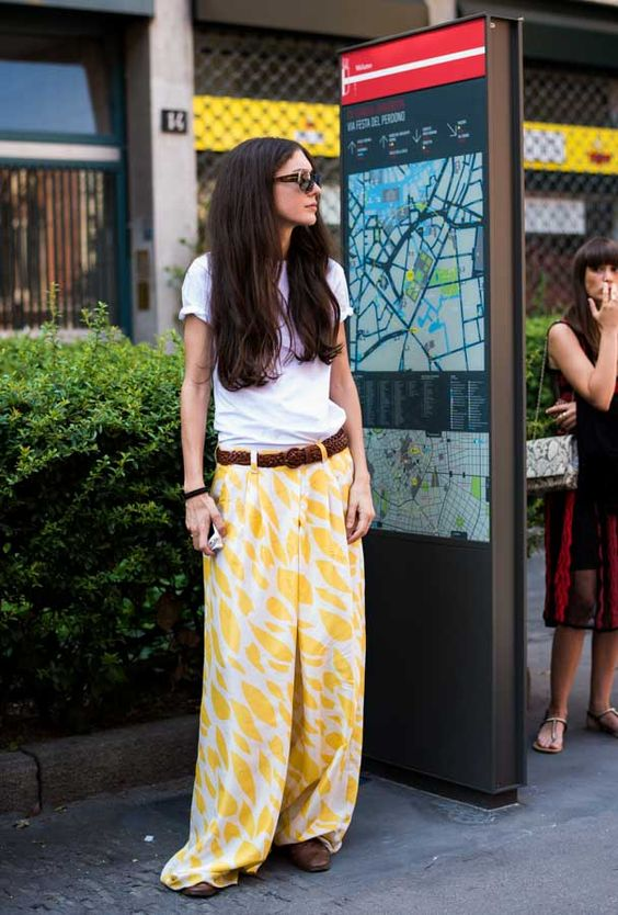 Womenswear Street Style. Diletta Bonaiuti wearing a relaxed outfit: yellow maxi skirt with white t-shirt and leather belt after Missoni show. Photography by Ángel Robles.  Fashion Photography from Milan Fashion Week.