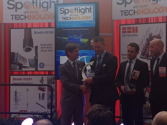 Brage Johannessen, Baker Hughes VP Drilling Services, accepts the 2013 OTC Spotlight on New Technology award for the FASTrak™ logging-while-drilling service.