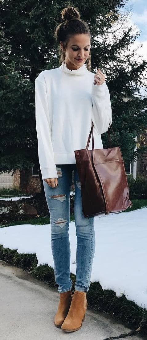 casual winter outfit idea : white sweater + bag + rips + boots