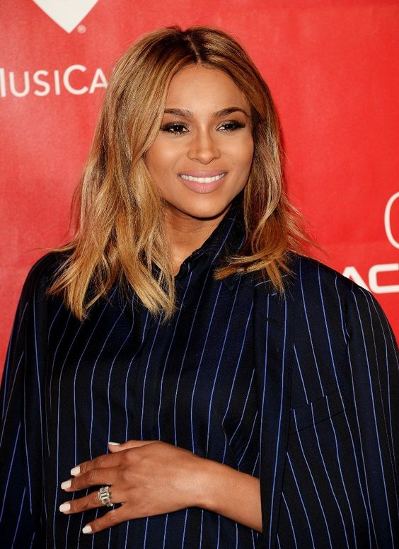 Ciara with medium length honey brown hair
