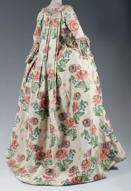 "Rear view, robe à la francaise, c. 1735. Cream figured silk damask brocaded with a floral design in ""Point Berclé"" technique."