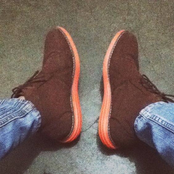 Orange-soled chocolate brown short boots.