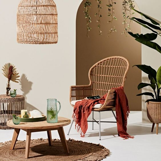 The final big trend for 2021 is introducing warmer colour palette. Terracotta, warm yellows and rusty reds. Think warm colours with those with undertones of red, yellow or orange. We love this set up of a woven chair, jute rug and basket pendant light all super casual pieces warmed up with the terracotta throw. Click the image for more on interior design trends for 2021.