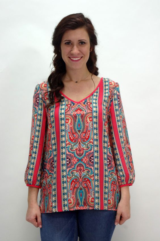 Be stylish with this Mi Amore Blouse! Pair this top with a tan/cream pair of shorts for around town with the girls or some dress slacks for at the office