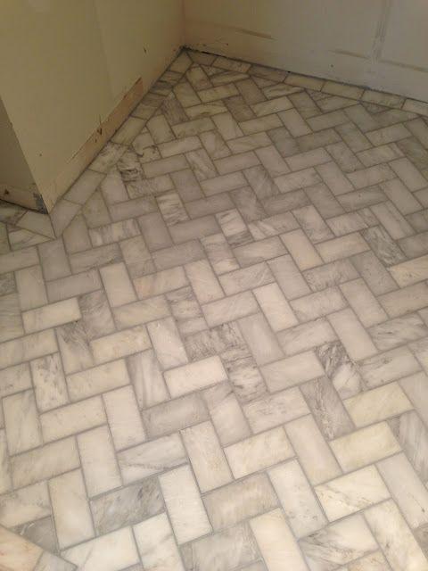 herringbone tile floors - grey grout