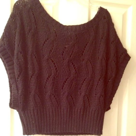 Cropped open knit sweater This is a shorter dolman sleeve open knit sweater... Layer with a tank... Color is black Sweaters