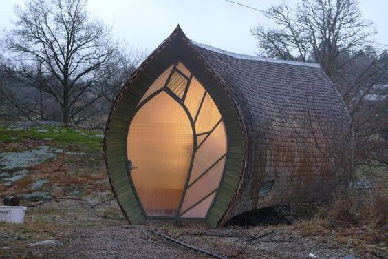 """Swedish designer Torsten Ottesjö's Hus.Ett (that's Swedish for """"House One""""). Ett house is a beautiful woodland retreat with a sheen and shape reminiscent of one of Scandinavia's favorite fish - the herring."""