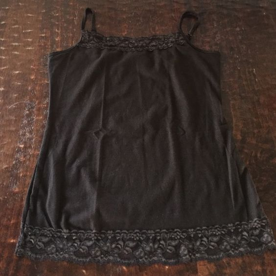 Large Brown Studio Y Cami with Lace Trim This Cami is by Studio Y and is sized Large. It has lace trim on both top and bottom of Cami. The spaghetti straps are adjustable. This Cami is in excellent condition, having been worn all of a handful of times. Feel free to mix and match Camis/tanks. Don't hesitate to make an offer. Studio Y Tops Camisoles