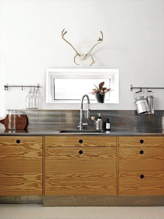 10 Stylish Kitchens with Stainless Steel Countertops Intrigued by use of backsplash lip and its ability to look non-terrible. Wood cabinets are awesome.