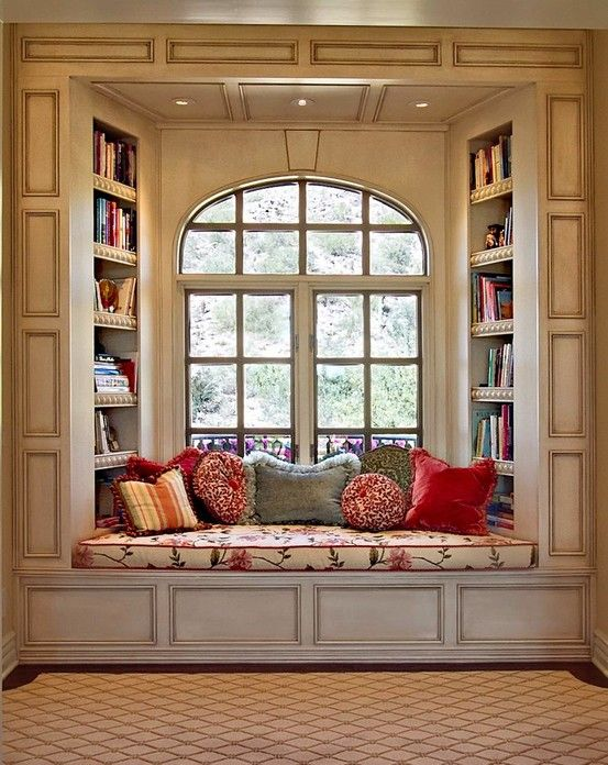 Something similar but move the bookshelves on to the walls flanking the window, so you get more light in: