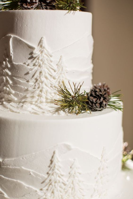 Love the pine cones and tree frosting details to accent this winter wedding cake!