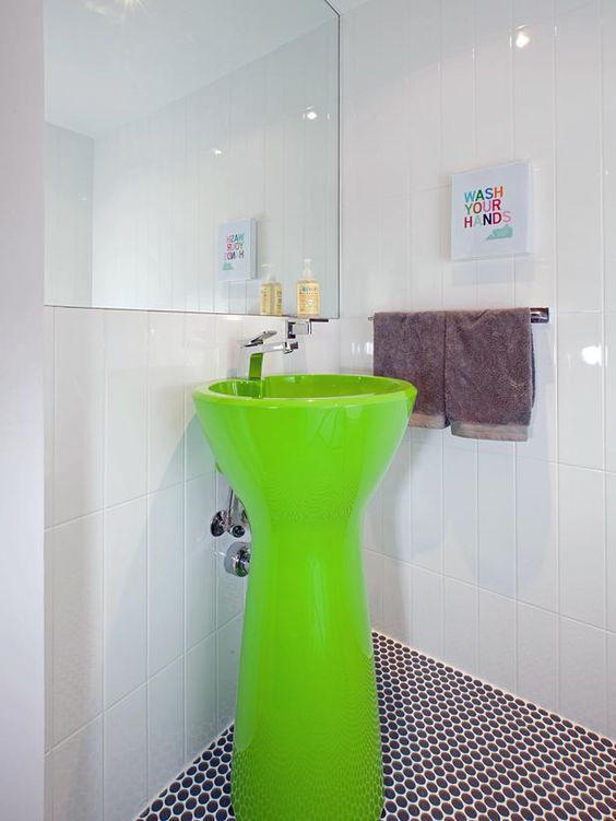 Melanie Morris of Feathered Nest Interiors chose this neon green sink because it resembles a kid's toy.