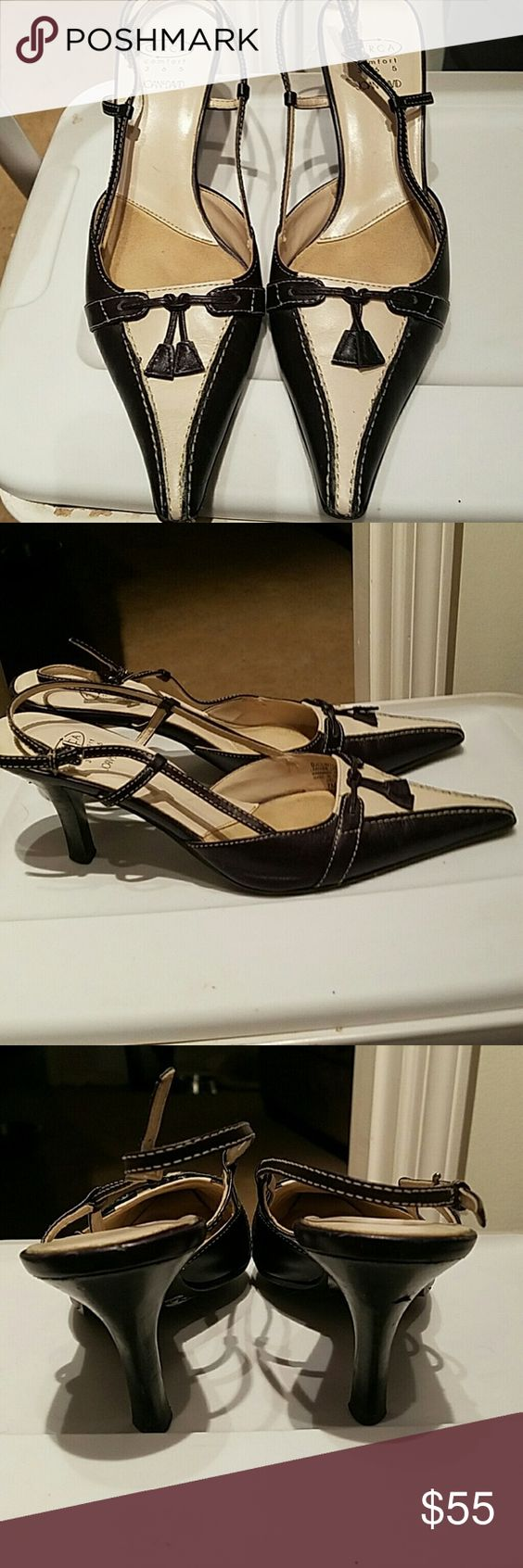 "Joan & David Circa Comfort Navy Blue & Ivory Heels This is a pair of Joan & David Circa Comfort heels!  These shoes have a nice rubber type sole, size US 7, pointed toes, w/tassels! Good-looking heels that r approx 3 1/2"". Joan & David Shoes Heels"
