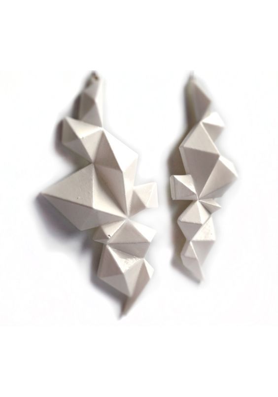Geometric shapes/designs are in this season. Be in style, but stay unique with an original design. White polished nylon finished with coats of a white lacquer. - See more at: http://supermarkethq.com/product/edgy-geometric-earrings-white#sthash.nGhwLVpy.dpuf