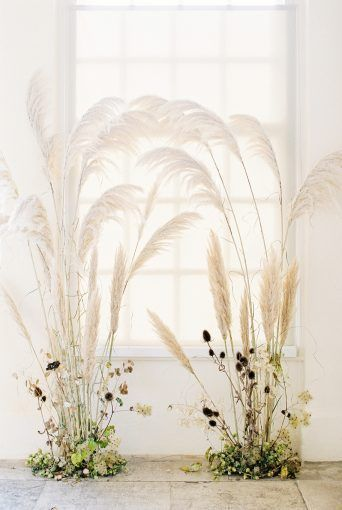 Dreamy wedding ceremony backdrop design with trendy pampas grass by Floribunda Rose, styled by Kate Cullen and captures by Bowtie and Belle Photography, featured on B.LOVED Blog!