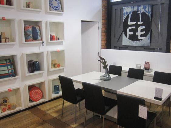 "BoConcept Expanding dining table and ""Life"" art"