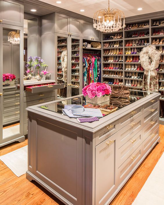 Glass-topped island, mirrored doors, jewelry dresser, and lots of shoes!  Marks & Frantz - gray closet