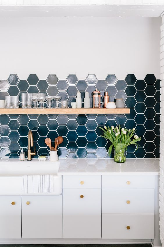 Wit and Delight's Studio Kitchen // A hexagonal tile backsplash is the perfect backdrop to this chic and organic studio kitchen. Gold, copper, live-edge wood, and fresh flowers keep things bright and approachable.: