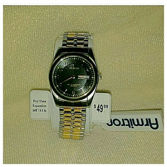 Armitron watch brand new Brand new with box and warranty is enclosed still. Was given to my husband as a gift and he doesn't wear watches.  Day and date features. Water resistant to 165 ft. Gold and stainless. Armitron Accessories Watches