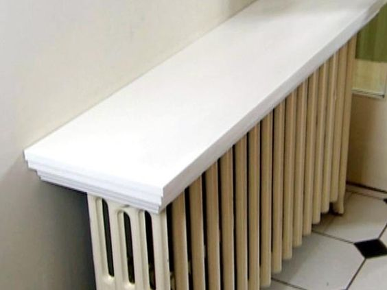 """Check out this idea to turn your old radiator into a """"totally rad"""" shelf. From the experts at HGTV.com."""