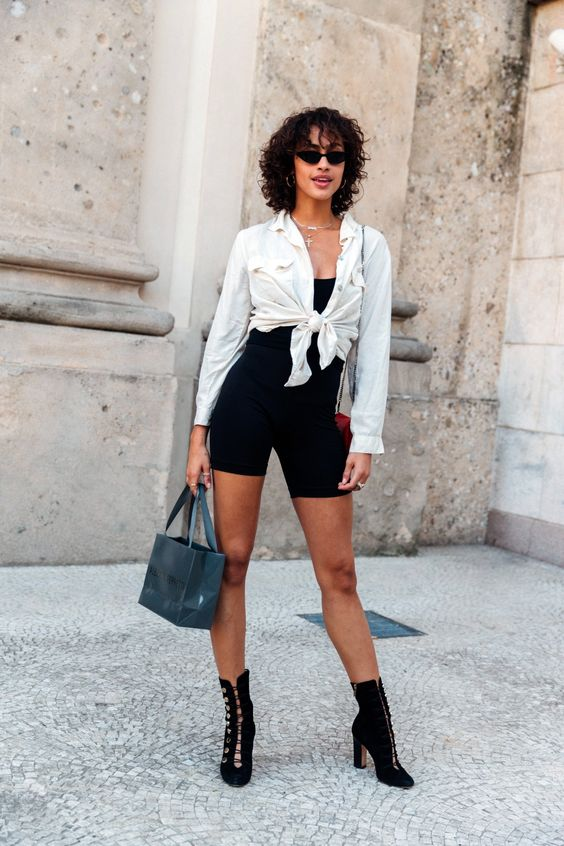 Tie up a white button-down over black bike shorts and top and, boom, you're done.